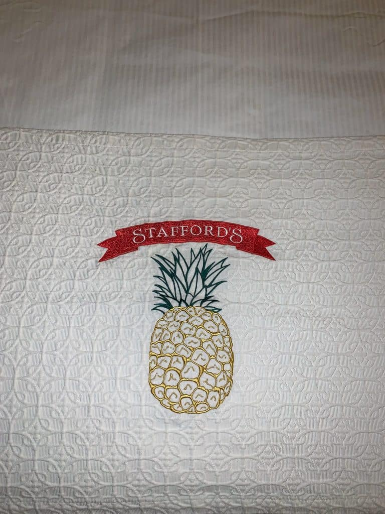The Logo of Stafford's Hospitality is a Pineapple.